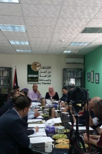In a debate organized by AMAN , State Institution's consensus on the ratification of the Palestinian Archive Law