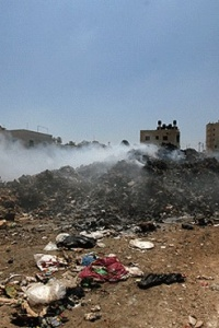 Recommendation to establish a community commission and pledge to address unregulated dump sites in the Gaza Strip